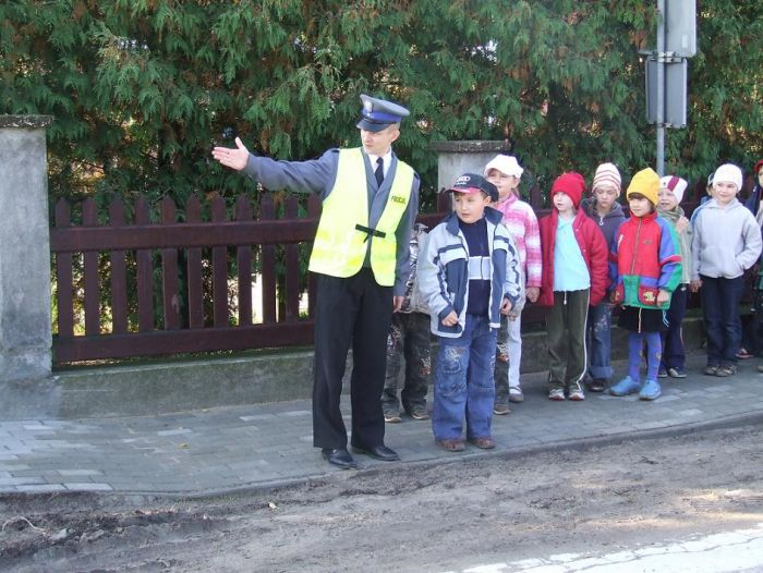 Polish policeman on duty protecting young members of the public in his community